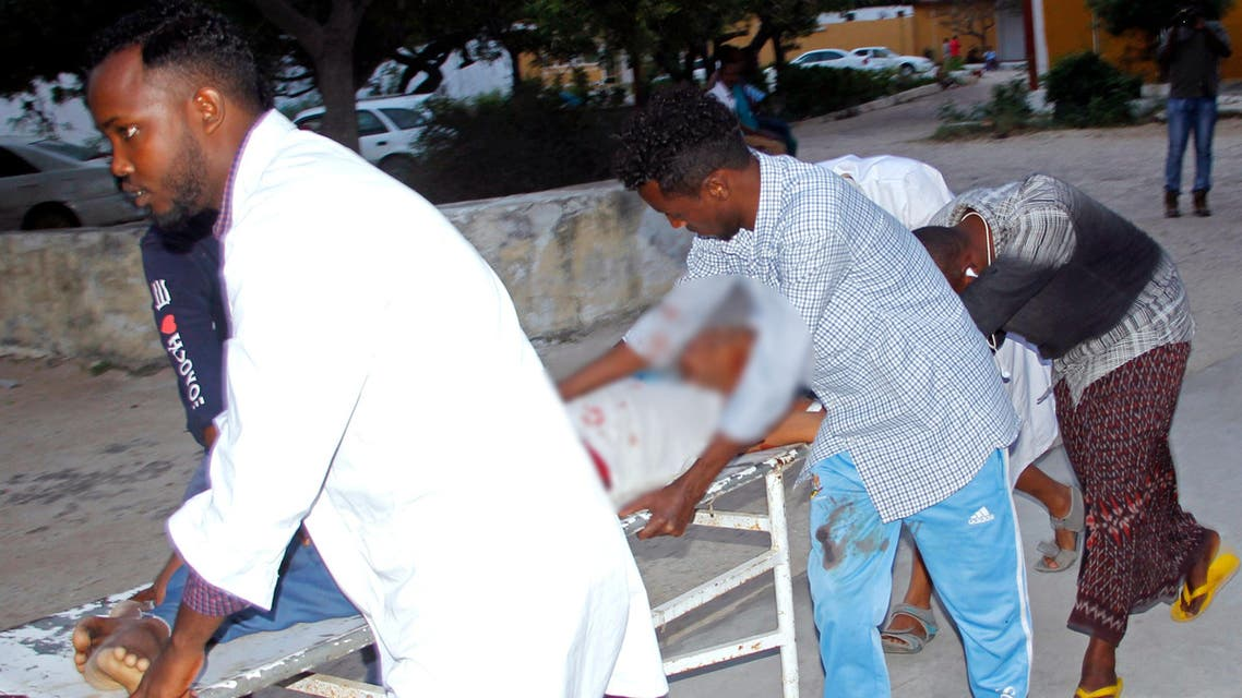 Medical workers help civilian on stretcher who was wounded in suicide bomb, at Madina hospital, Mogadishu. (AP)