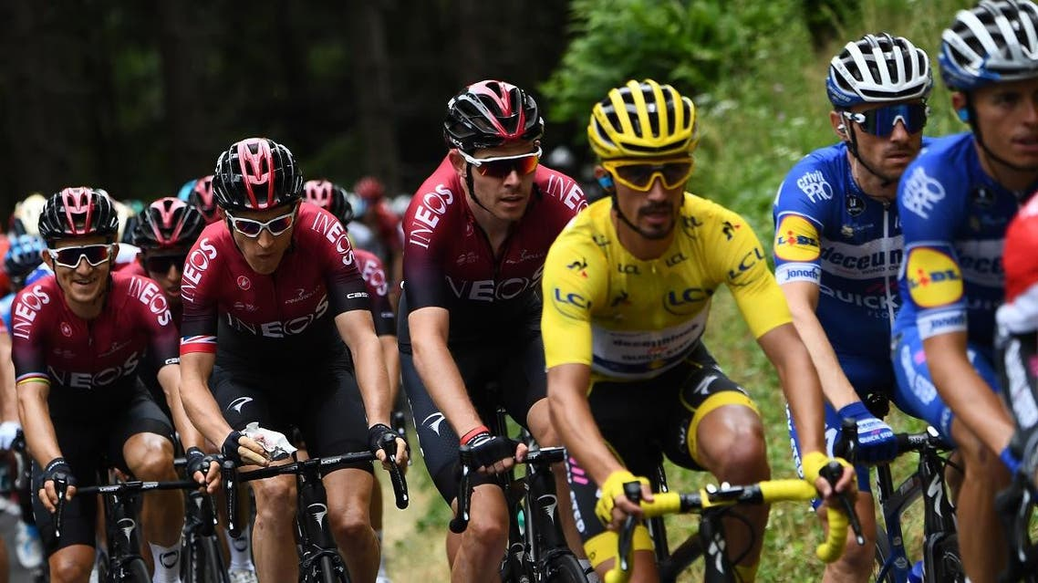 Great Britain's Luke Rowe (C) follows France's Julian Alaphilippe (3rdR), wearing the overall leader's yellow jersey during the sixth stage of the 106th edition of the Tour de France cycling race between Mulhouse and La Planche des Belles Filles, on July 11, 2019. (AFP)