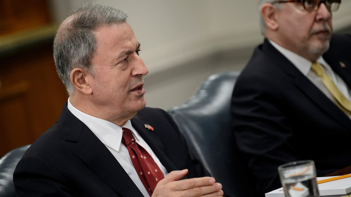 Turkish Defence Minister Hulusi Akar looks on before posing for a family picture during the NATO Defence Ministers meeting in Brussels on June 27, 2019.