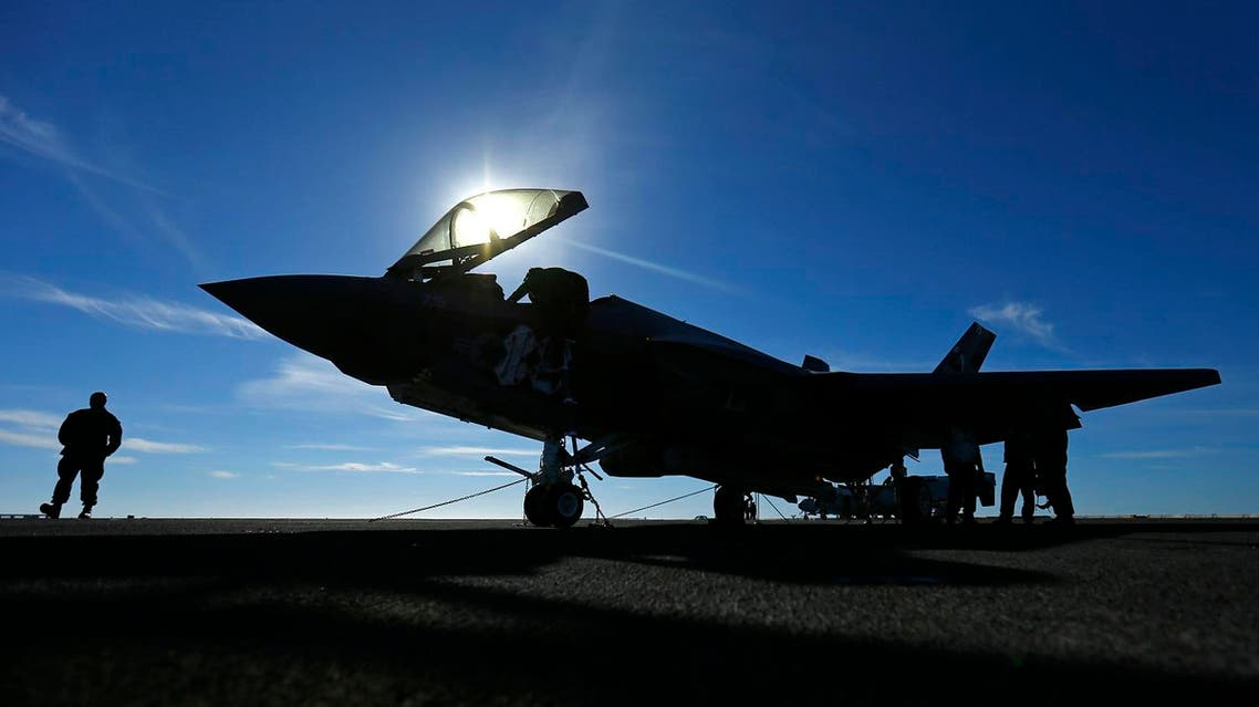 A Lockheed Martin Corp's F-35C Joint Strike Fighter is shown on the deck of the USS Nimitz aircraft carrier after making the plane's first ever carrier landing using its tailhook system, off the coast of California, November 3, 2014. (Reuters)