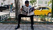 Mourning leader, Tunisians look forward to smooth transition