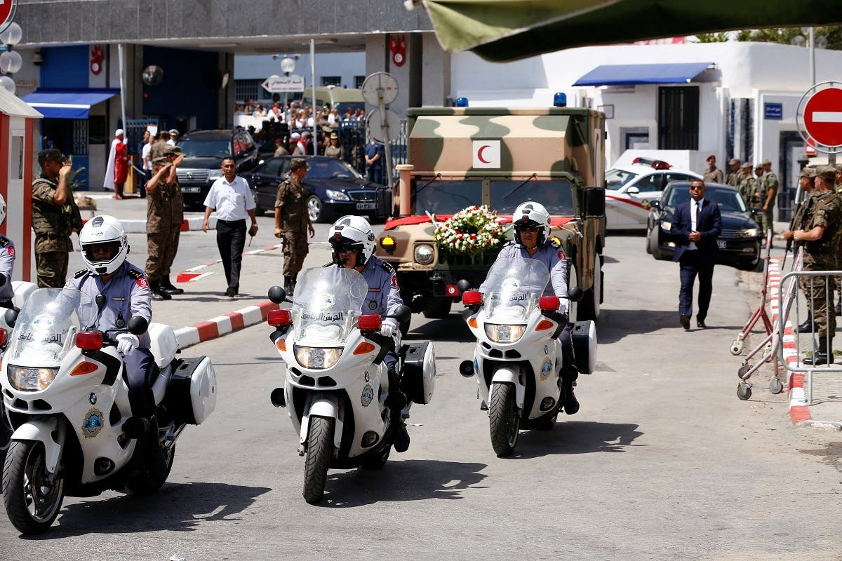 A general view shows an ambulance that carries the body of late Tunisian President Beji Caid Essebsi in Tunis, Tunisia on July 26, 2019. (Reuters)