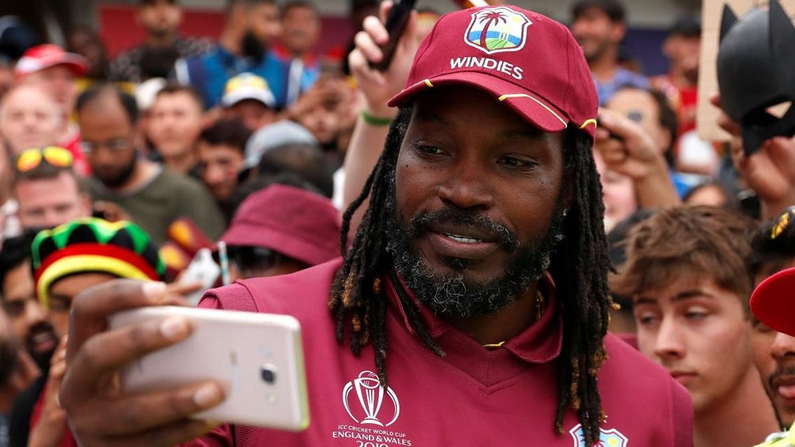 West Indies' Chris Gayle poses for a photo with fans as he celebrates after the match against Afghanistan during the ICC Cricket World Cup at Headingley, Leeds, Britain, on July 4, 2019. (Reuters)