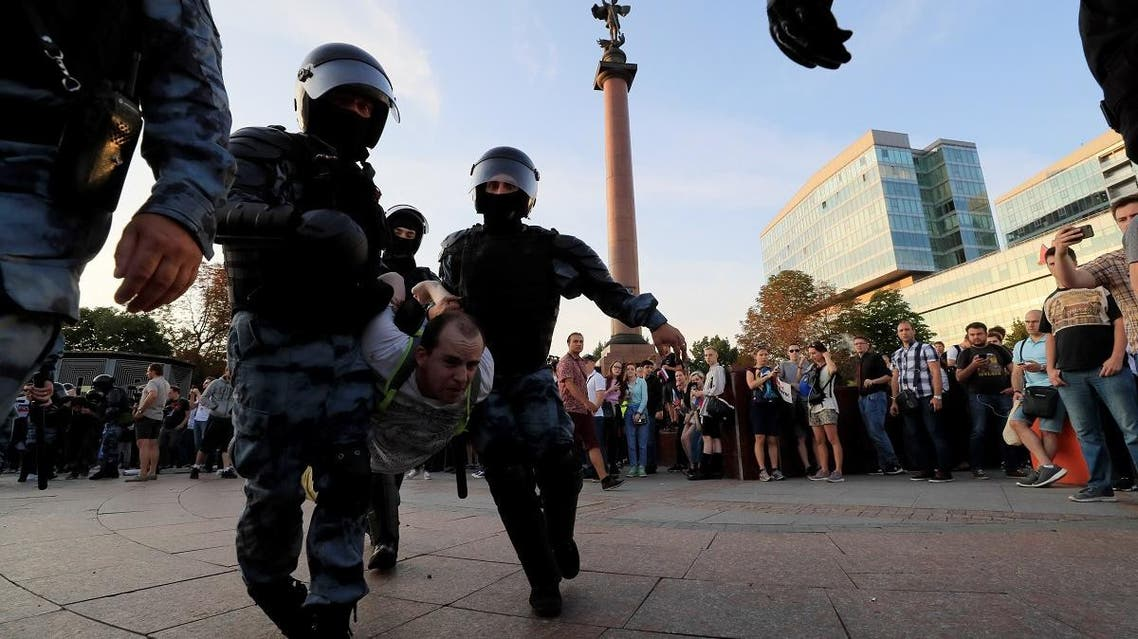 Law enforcement officers detain a participant of a rally calling for opposition candidates to be registered for elections to Moscow City Duma, the capital's regional parliament, in Moscow. (Reuters)