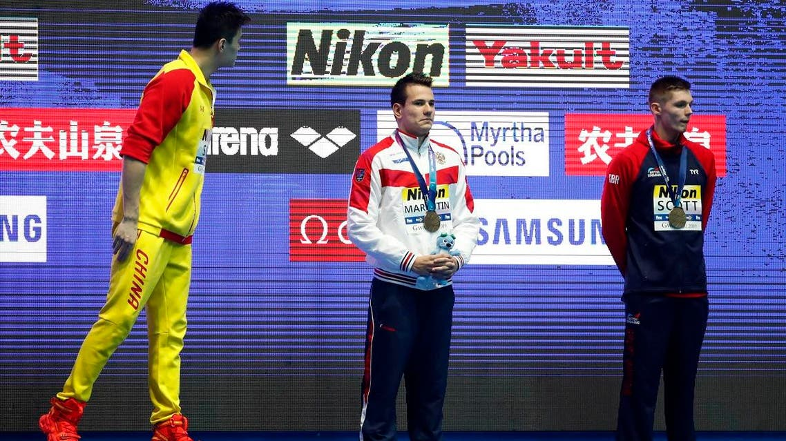 Gold medalist Sun Yang of China reacts on podium next to joint bronze medalists Martin Malyutin of Russia and Duncan Scott of Britain during the 18th FINA World Swimming Championships at Gwangju, South Korea on July 23, 2019. (Reuters)