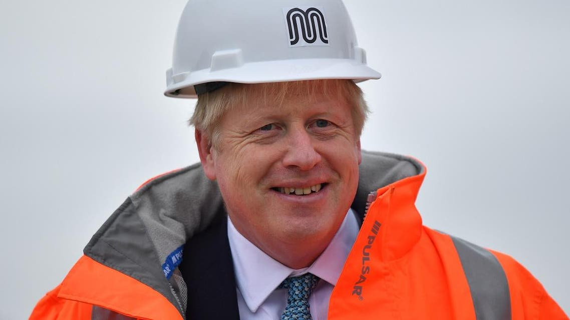 Britain's Prime Minister Boris Johnson reacts as he meets engineering graduates on the site of an under-construction tramline in Stretford, near Manchester, Britain, on July 27, 2019. (Reuters)