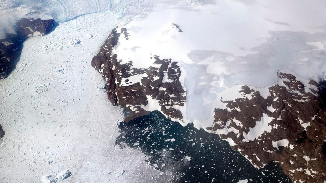 File photo of a glacier at left calves icebergs into a fjord off the Greenland ice sheet in southeastern Greenland. (AFP)