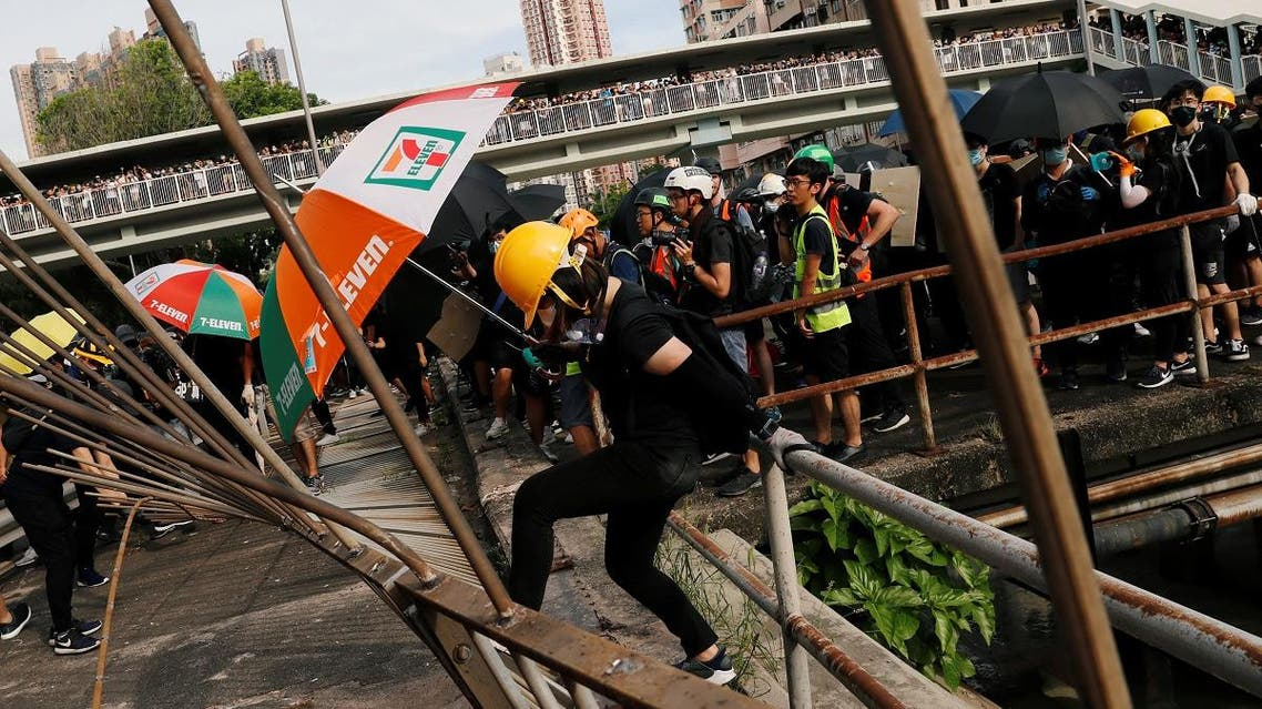Protesters pull down a fence near Nam Pin Wai village during a protest against the Yuen Long attacks in Yuen Long, New Territories, Hong Kong. (Reuters)