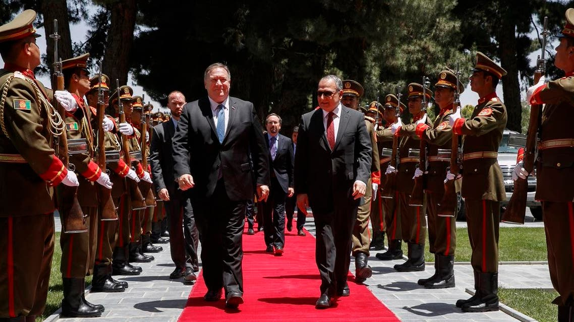 Secretary of State Mike Pompeo (center left), walks with Afghan President Ashraf Ghani's Chief of Staff Abdul Salam Rahimi, as he arrives at the Presidential Palace in Kabul, Afghanistan, on June 25, 2019, during an unannounced visit. (AFP)