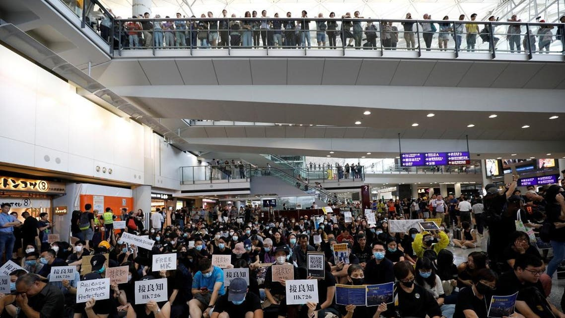 Protesters and members of the aviation industry stage a protest against the recent violence in Yuen Long, at Hong Kong airport, China, on July 26, 2019. (Reuters)