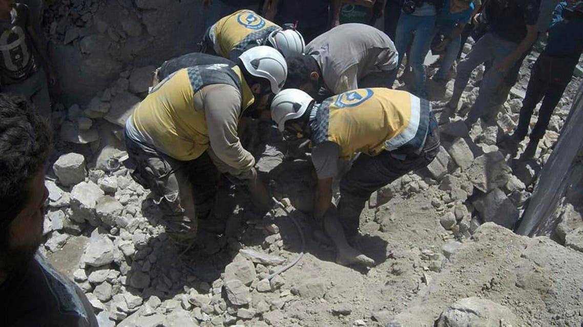 Syrian White Helmet civil defense workers pull out a victim from under the rubble of a destroyed building that hit by a Syrian government airstrike. (File photo: AP)