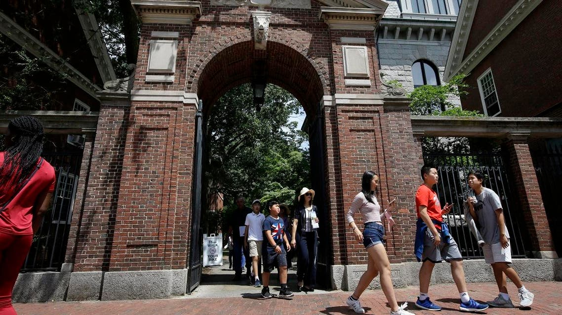 In this Tuesday, July 16, 2019 photo people walk through a gate as they depart Harvard Yard, at Harvard University, in Cambridge, Mass. (AP)