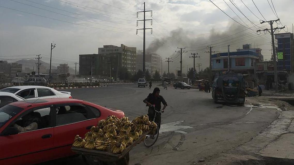 Smoke rises from the site of an attack targeting the Kabul office of the running mate of Afghan President Ashraf Ghani in Kabul. (AFP)
