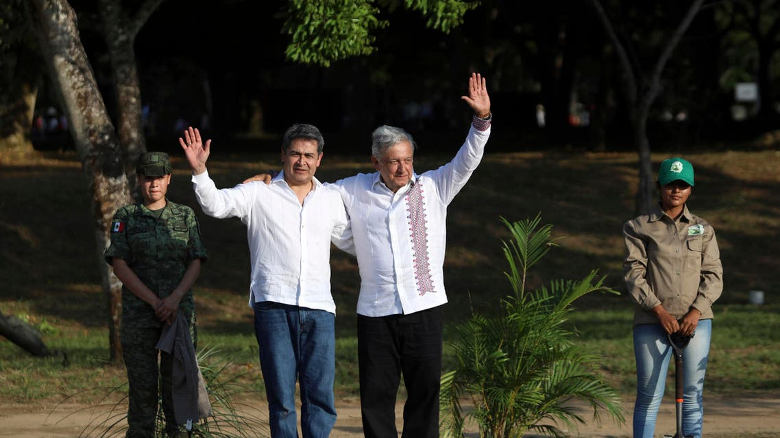 Honduras' President Juan Orlando Hernandez, left, and Mexico's President Andrés Manuel López Obrador, pose for photos on a military base in Minatitlan, Mexico, Saturday, July 27, 2019. (AP)