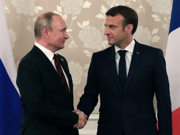 بوتين وماكرون يتفقان على التهدئة في كاراباخ.. خلافات حول بيلاروسيا