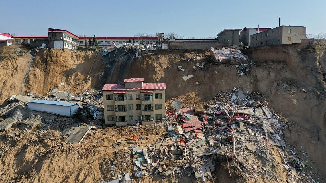 This photo taken on March 16, 2019 shows rescuers working at the site of a landslide in Xiangning county in Linfen city in China's northern Shanxi province. (AFP)