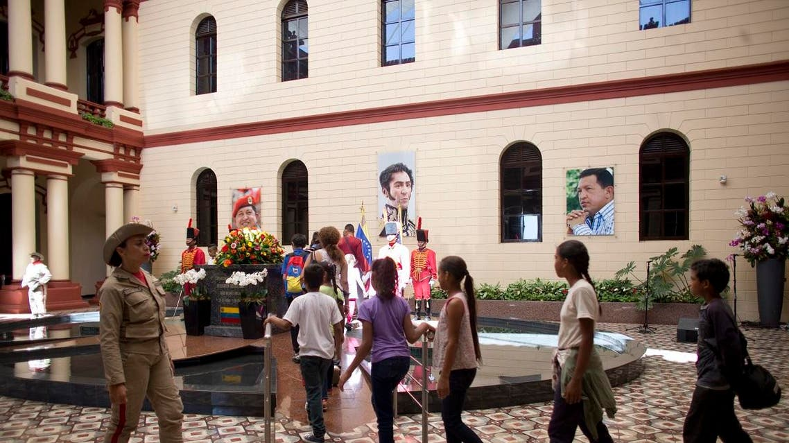 People visit the tomb of Venezuela's late President Hugo Chavez inside the 4F military museum in Caracas, Venezuela, on July 28, 2019, on his birthday anniversary. (AP)