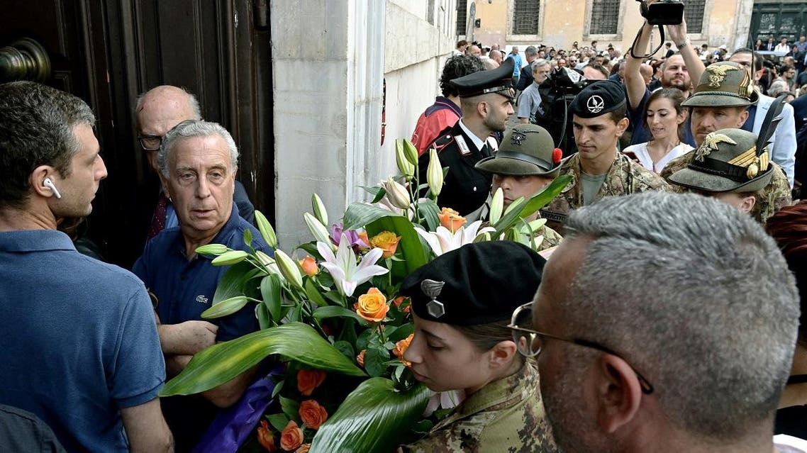 People and Carabinieri arrive to pay their respects in the church where Italian police officer Mario Cerciello Rega lies in state, in downtown Rome on July 28, 2019. (AFP)
