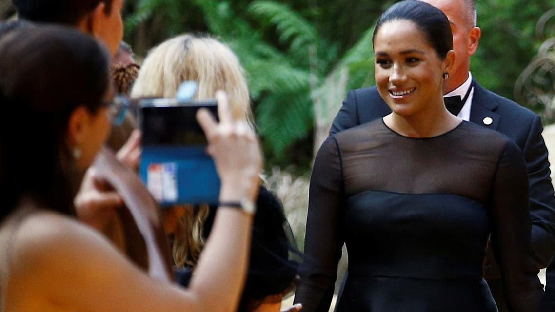 """Britain's Meghan, Duchess of Sussex, poses for pictures as she attends the European premiere of """"The Lion King"""" in London, on July 14, 2019. (Reuters)"""
