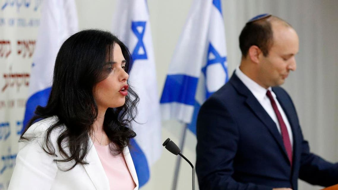 """Israel's Minister of Education Naftali Bennett (R) and Israeli Justice Minister Ayelet Shaked (L) announce the formation of new political party HaYemin HeHadash or """"The New Right"""", during a press conference in the Israeli Mediterranean coastal city of Tel Aviv on December 29, 2018. (AFP)"""