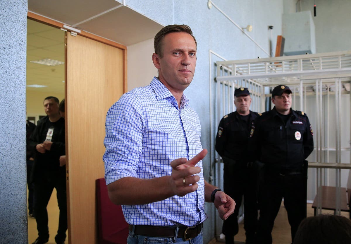 File photo of Russian opposition leader Alexei Navalny, who is charged with participation in an unauthorised protest rally, addresses journalists after a court hearing in Moscow. (Reuters)