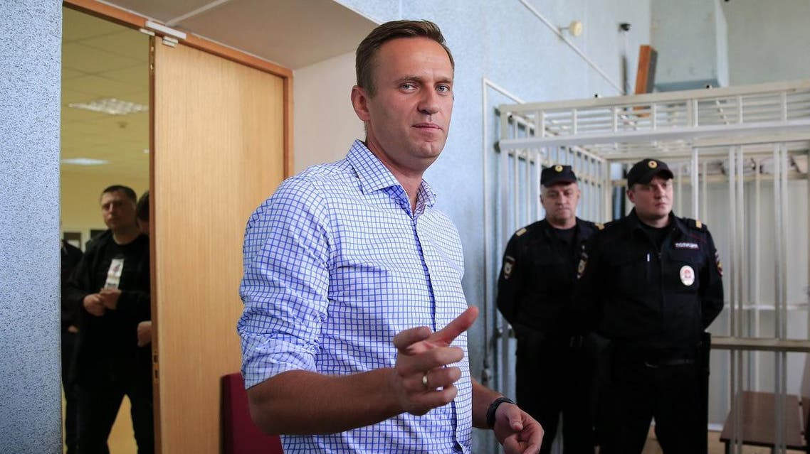 Russian opposition leader Alexei Navalny, who is charged with participation in an unauthorised protest rally, addresses journalists after a court hearing in Moscow. (Reuters)
