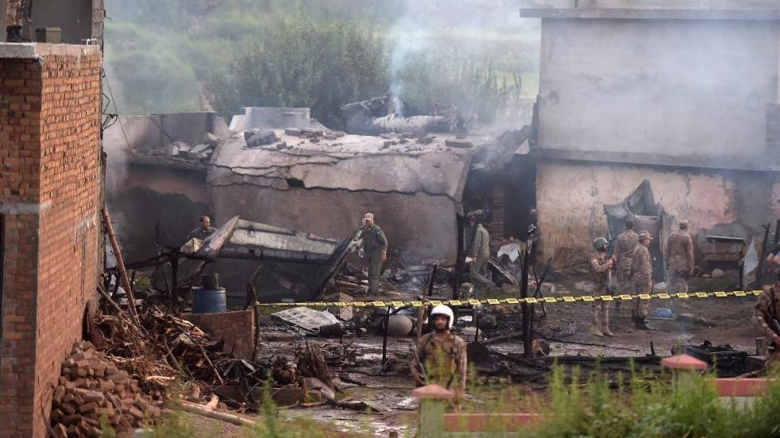 Soldiers cordon off the site where a Pakistani Army Aviation Corps aircraft crashed in Rawalpindi on July 30, 2019. AFP