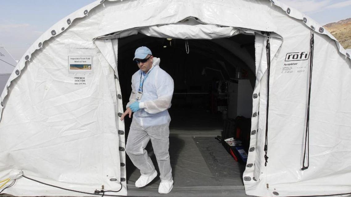 An Inspector from the Comprehensive Nuclear-Test-Ban Treaty (CTBT) organisation walks out of a tent during 2014 Integrated Field Exercise (IFE14) operation. (File photo: AFP)