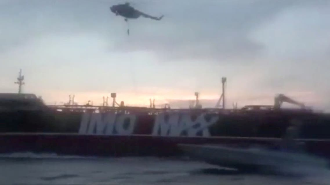 An Iranian Revolutionary Guard troop member rapels to British-flagged tanker Stena Impero's deck from a helicopter near the strait of Hormuz July 19, 2019, in this still image taken from video. Picture taken July 19, 2019. Pool via WANA/Reuters TV via REUTRS. IRAN OUT. NO COMMERCIAL OR EDITORIAL SALES IN IRAN. NO USE BBC PERSIAN. NO USE MANOTO. NO USE VOA PERSIAN
