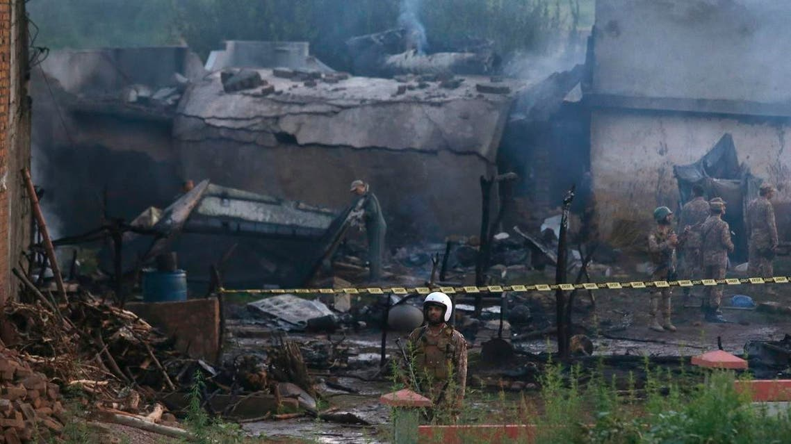 Pakistan army officials examine the site of a plane crash in Rawalpindi, Pakistan, Tuesday, July 30, 2019. (AP)