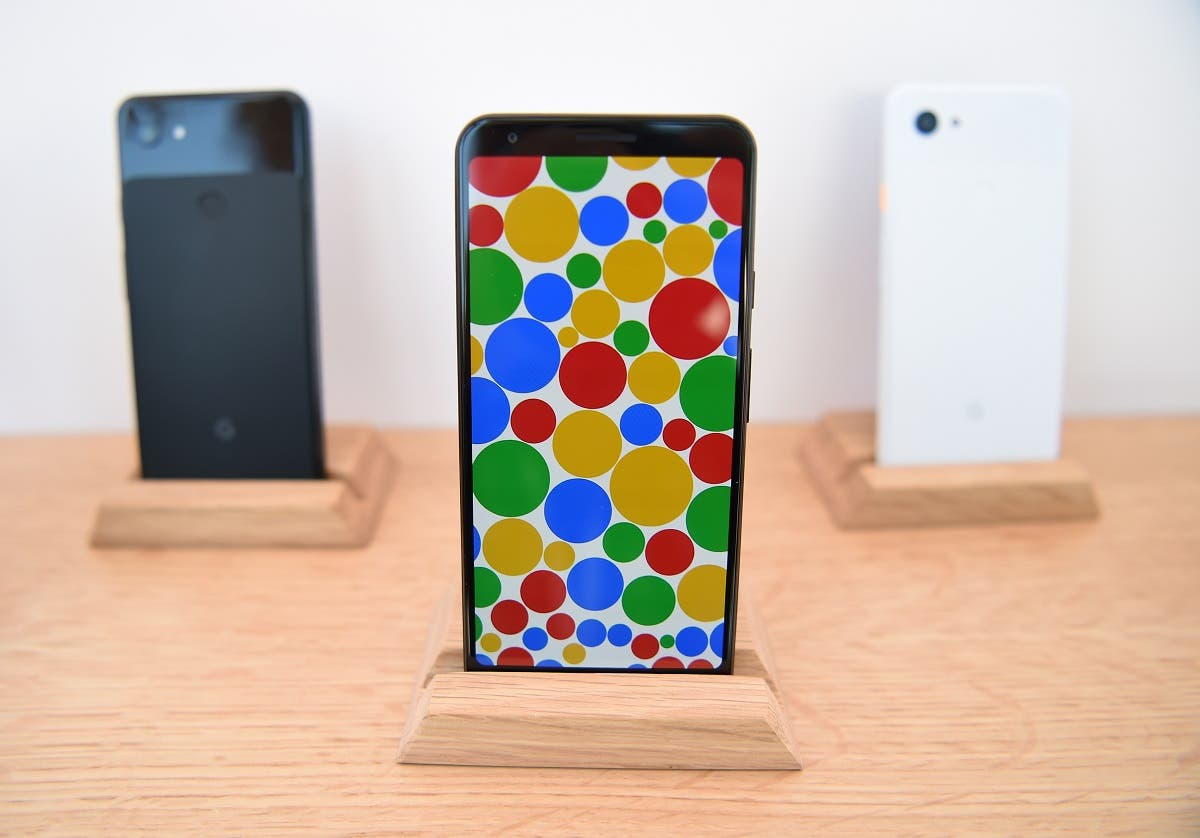 A new Google Pixel 3a phone (C) is displayed during the Google I/O conference at Shoreline Amphitheatre in Mountain View, California on May 7, 2019. (AFP)