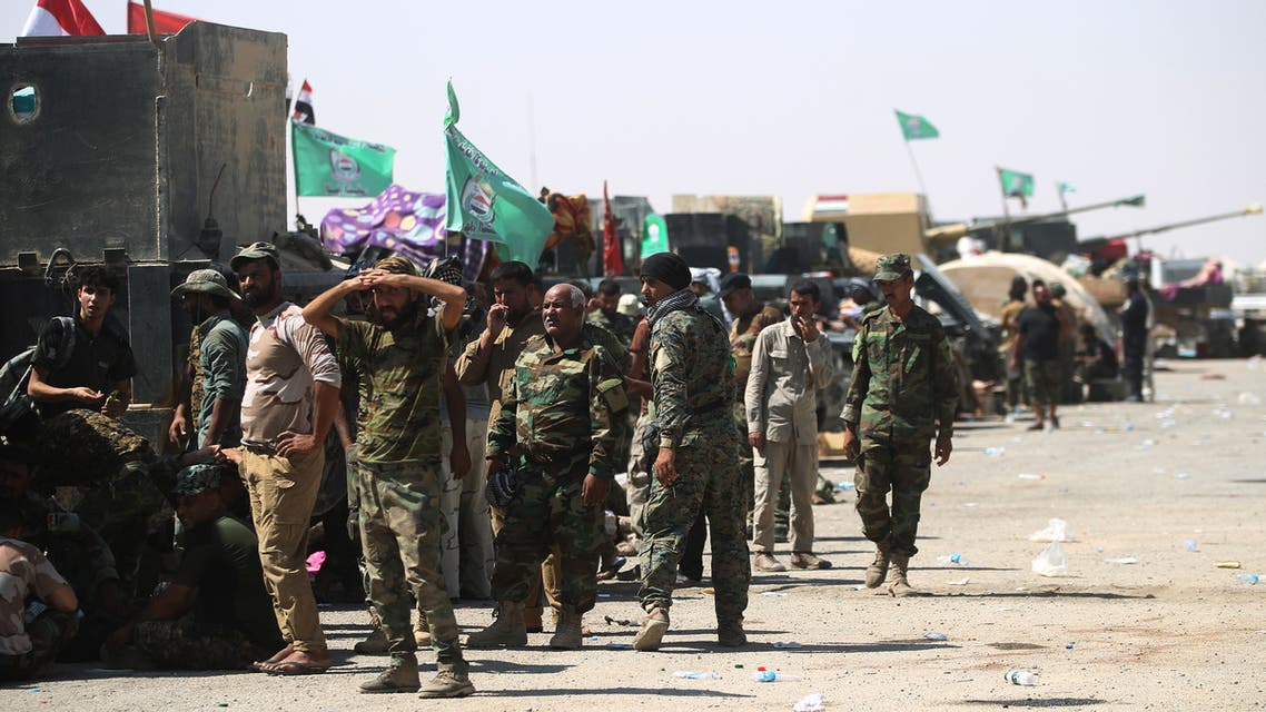 Fighters of Hashed Al-Shaabi (Popular Mobilization units) gather at the Tal Afar airport, west of Mosul, as Iraqi forces backed by local militia and a US-led coalition advanced in driving the Islamic State group from the city, on August 27, 2017. Just a week after authorities announced an offensive to push the jihadists from one of their last major urban strongholds in Iraq, the Joint Operations Command said Iraqi forces held all 29 districts of the city and were pursuing final mopping up operations.