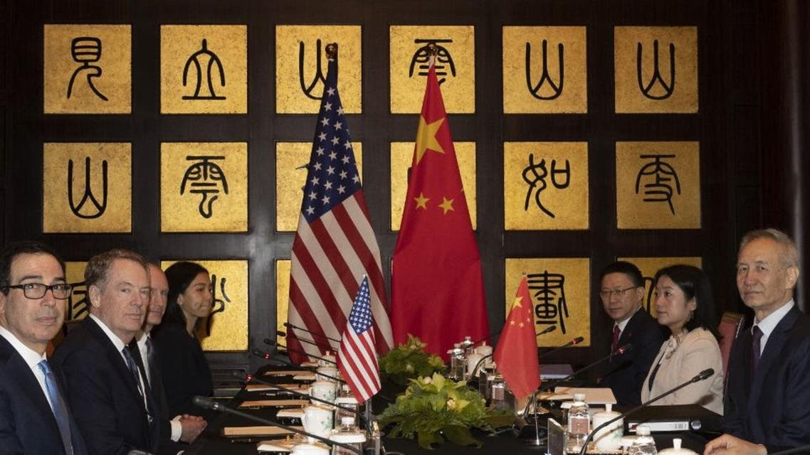US Trade Representative Robert Lighthizer and Treasury Secretary Steven Mnuchin shook hands with Chinese Vice Premier Liu He before beginning trade talks in Shanghai AFP