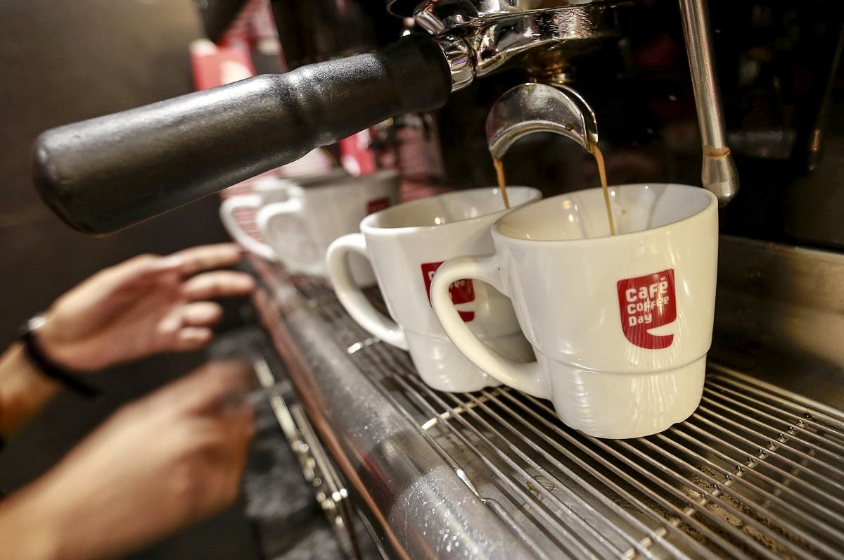 An employee prepares coffee for customers at a Cafe Coffee Day outlet in Mumbai, India. (Reuters)