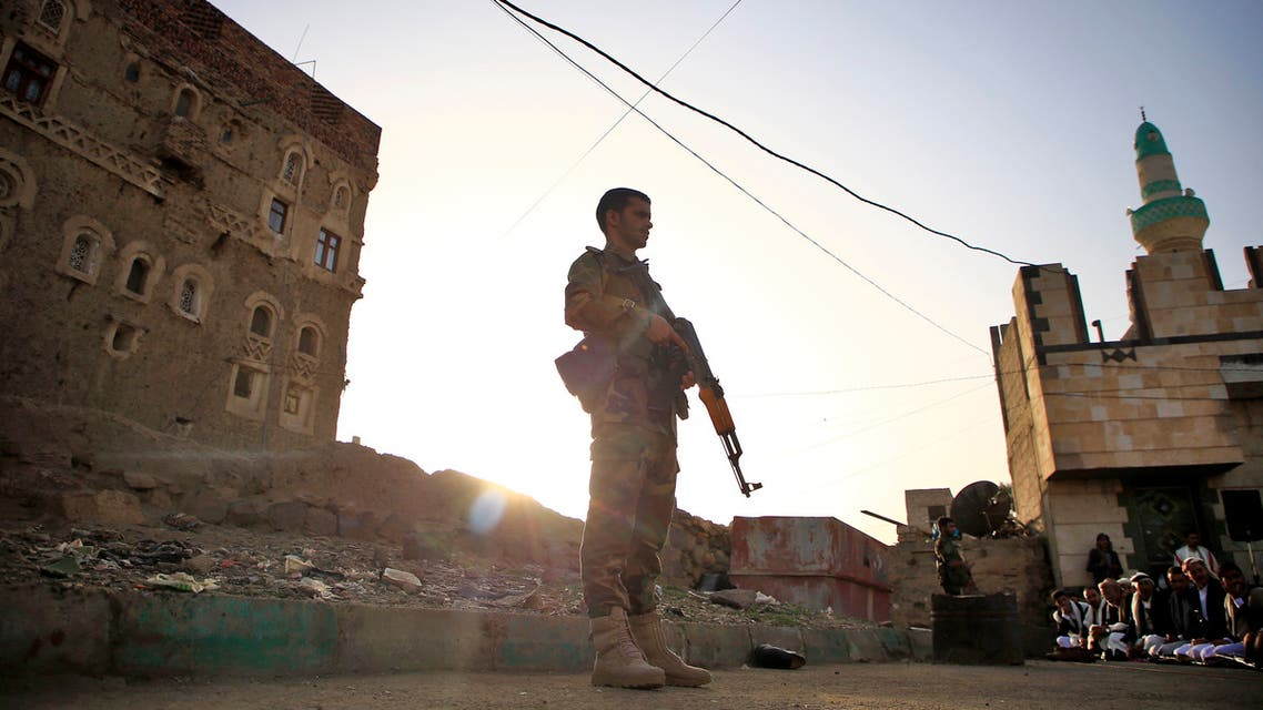 Yemeni security forces loyal to the Huthi-rebel government stands guard as Muslim worshippers perform Eid al-Fitr prayers at a square in the capital Sanaa on June 5, 2019, marking the end of the fasting month of Ramadan.