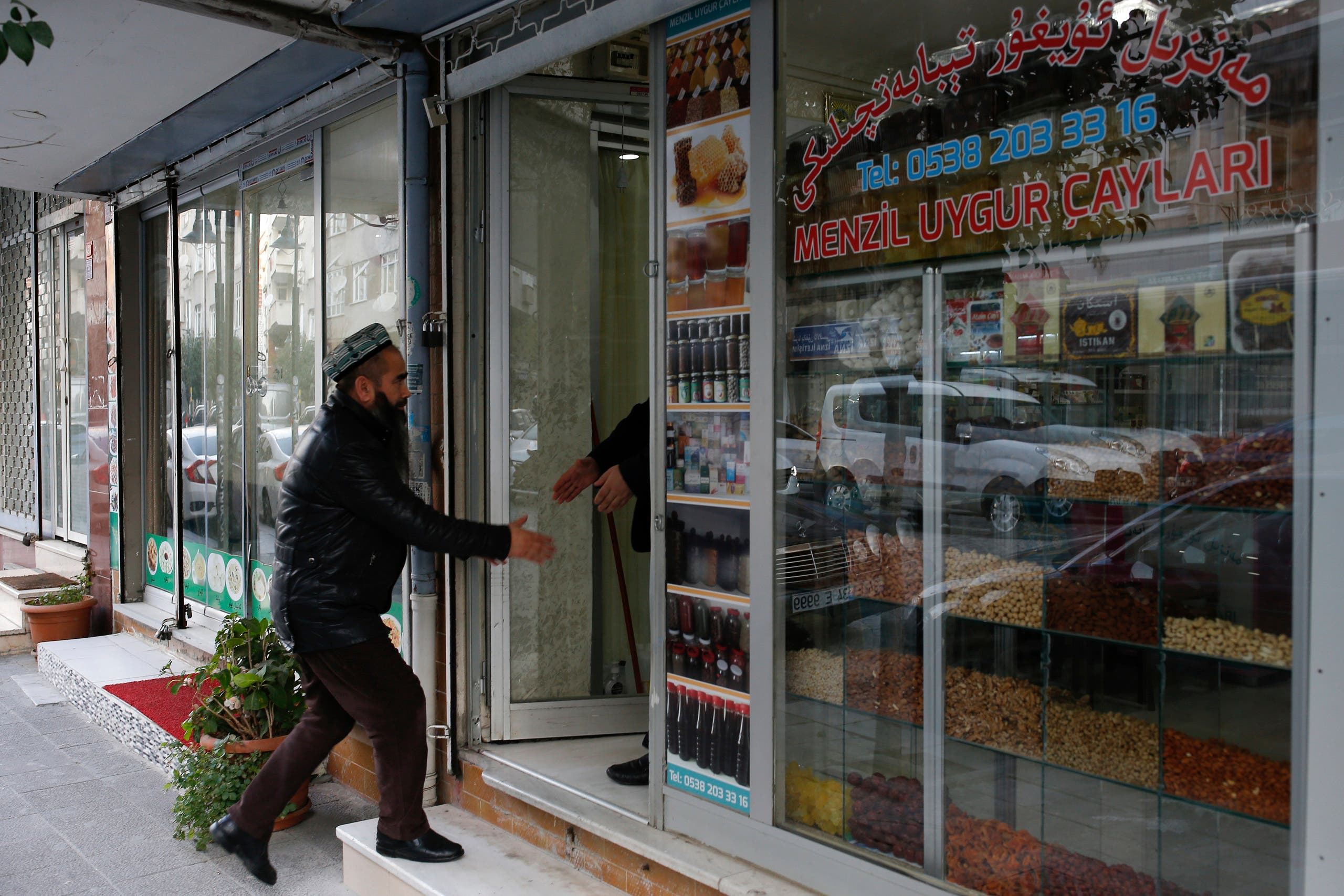 A man enters a halal restaurant in china (AP)