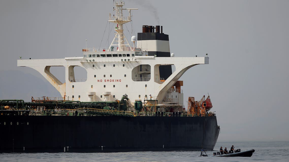 FILE PHOTO: Gibraltar defence police officers guard the Iranian oil tanker Grace 1 as it sits anchored after it was seized earlier this month by British Royal Marines off the coast of the British Mediterranean territory on suspicion of violating sanctions against Syria, in the Strait of Gibraltar, southern Spain July 20, 2019. REUTERS/Jon Nazca/File Photo