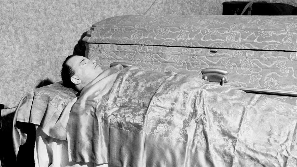 The body of slain outlaw John Dillinger lies in state at the Harvey Funeral Home in Mooresville, Ind., July 25, 1934. The body will later be placed in the casket shown in background. (AP Photo)