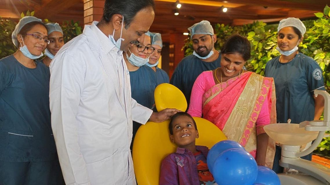 Doctors pose with a 7-year-old boy, whose tooth-like structures were removed from his mouth, at a hospital in Chennai, India, August 2, 2019. (Reuters)