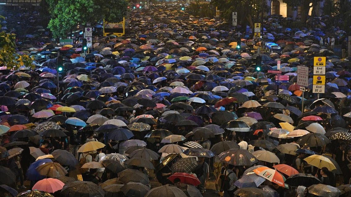 People attend a protest held by civil servants in the Central District of Hong Kong on August 2, 2019. (AFP)
