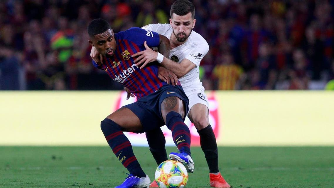 Barcelona forward Malcom (left), and Valencia defender Jose Gayà battle for the ball during the Copa del Rey soccer match final at the Benito Villamarin stadium in Seville, Spain, on May 25, 2019. (AP )