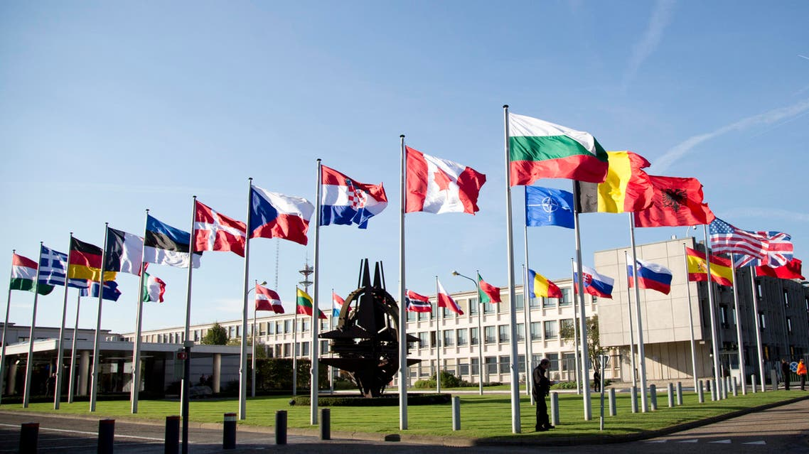 Flags of member countries flap in the wind in front of NATO headquarters in Brussels on Tuesday, Oct. 22, 2013. (AP)