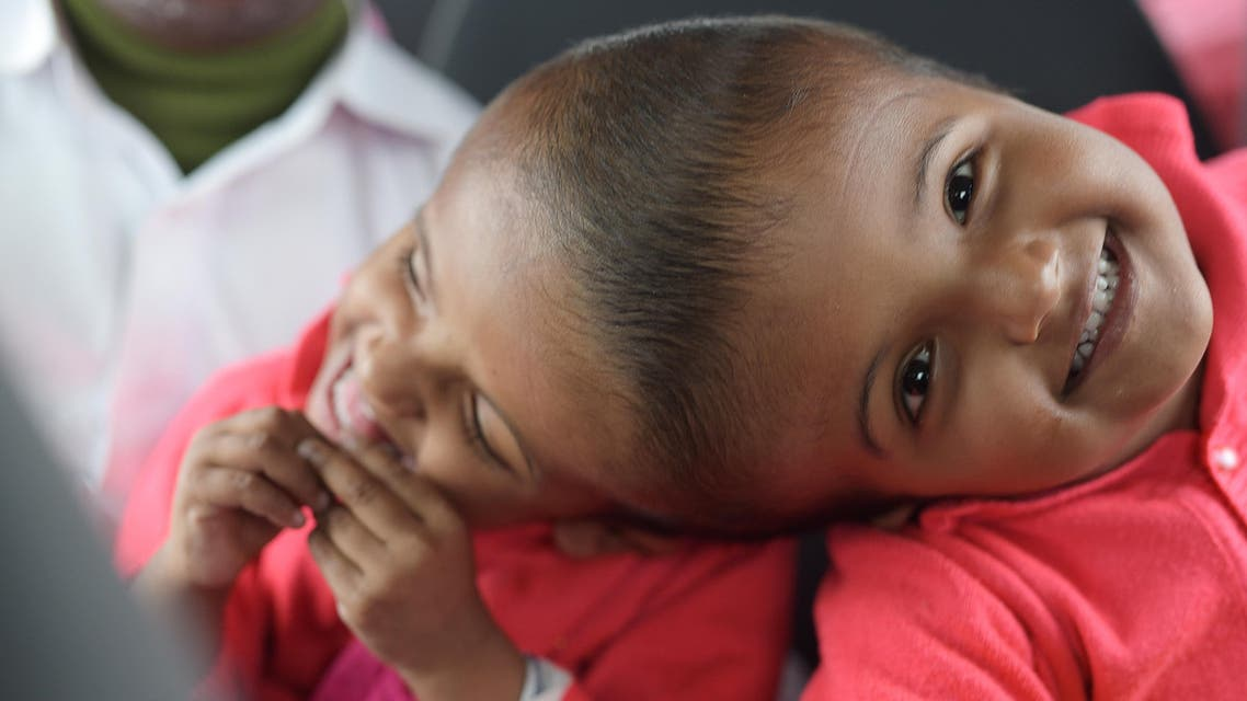 This handout photograph taken on January 5, 2019 and received on August 2 from the Action for Defenceless People Foundation (ADPF) shows conjoined Bangladeshi twins Rabeya and Rukaya during their visit to Budapest, in preparation for their their final separation surgery to be performed in Dhaka. (AFP)