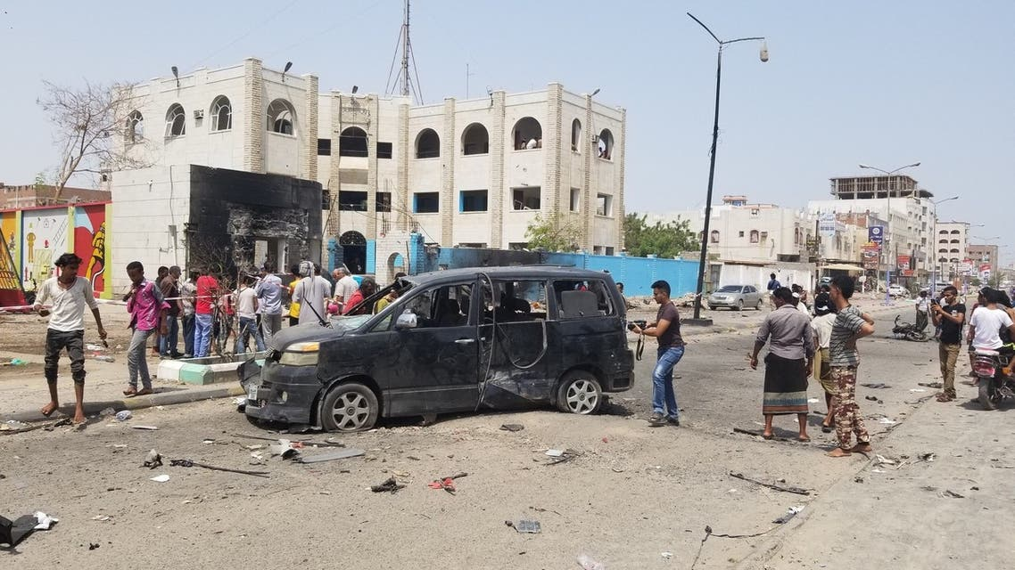 Yemenis walk past a crater at the site of a suicide car bombing on a police station in Sheikh Othman district, in Yemen's government-held second city Aden, on August 1, 2019. Separate attacks by Shiite rebels and a jihadist suicide bomber killed at least 27 people in Yemen's government-held second city Aden, many of them newly trained police cadets, security and medical sources said.