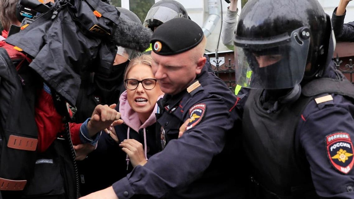 Law enforcement officers detain Russian opposition politician Lyubov Sobol before a rally calling for opposition candidates to be registered for elections to Moscow City Duma, the capital's regional parliament, in Moscow, Russia August 3, 2019. (Reuters)