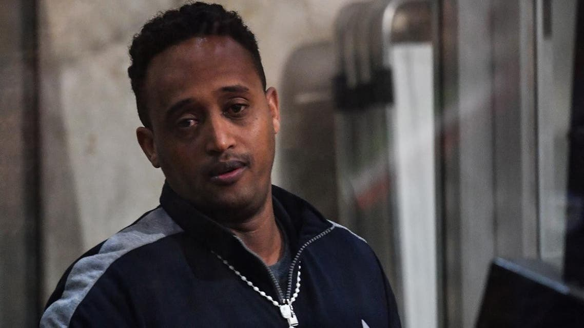 A man believed to be Eritrean Medhanie Yehdego Mered, the head of one of the largest migrant trafficking networks, but claims his identity has been mistaken and to be Medhanie Tesfamariam Behre, is pictured during a session of his trial at the Court of Palermo in Sicily on February 14, 2019. (AFP)
