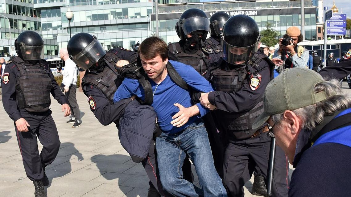 Police officers detain a man during an unsanctioned rally urging fair elections in downtown Moscow on August 3, 2019. (AFP)
