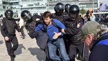 Moscow police use force to end election protest, arrest 600