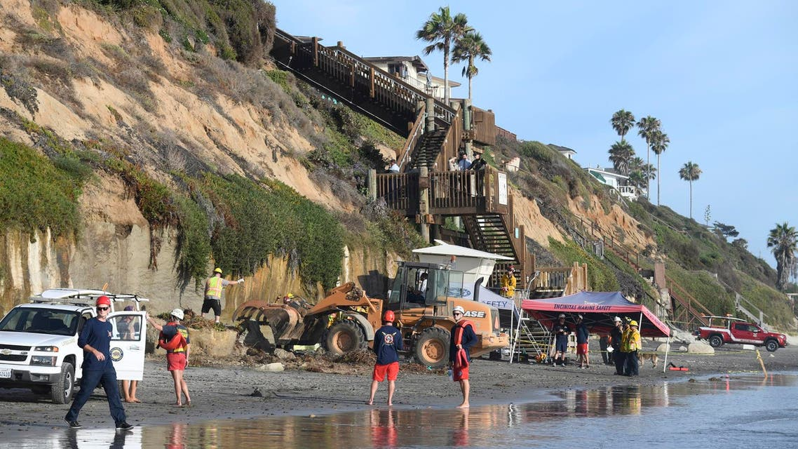 Search and rescue personnel work at the site of a cliff collapse at a popular beach Friday, Aug. 2, 2019, in Encinitas, California. (AP)