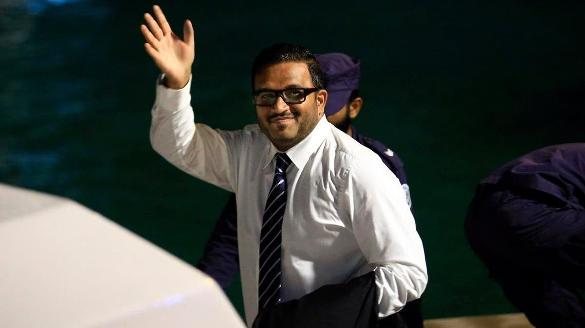 File photo of former Maldives vice president Ahmed Adeeb waves to the media before he boards a police speedboat in Maldives.  (AP)